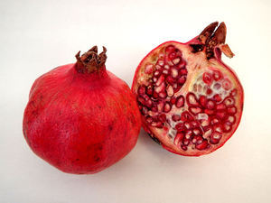 pomegranates2: well-known seedy fruit - cut open - exposed numerous embedded seeds