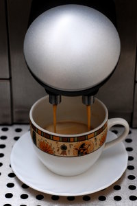 Making espresso in coffee mach
