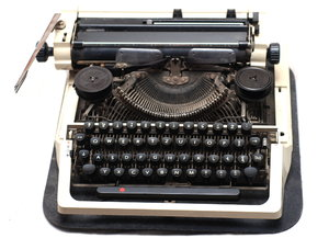 Typewriter 1: A typewriter is a mechanical or electromechanical device with a set of