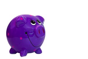 Purple Piggy Bank: A colourful, smiley piggy bank.  Lots of copy space.