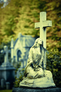 Mary: A Cross Processed image of Mary sitting at a Cross.