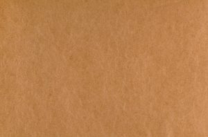 Smooth Cardboard Texture: A neutral brown detailed texture of a smooth cardboard sheet.