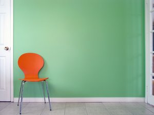 Green Wall 1: Orange chair in front of a green wall.