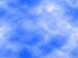 Cloudy Sky 9: White clouds in a blue sky make a great texture or background.