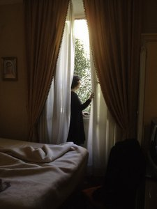 Rome_6: A woman looking out from her room