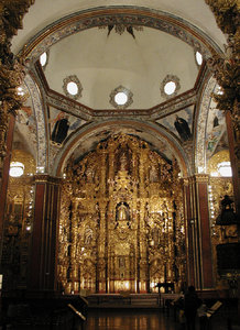 Tepotzotlan: One of the most important masterpieces of colonial baroque in Latinamerica is the altar of San Francisco Javier, at Tepotzotlan Mexico.  This is a shot of the wood altar all covered with laminated gold. I wish the image coud be more clearly detailed, but