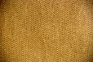 Textured Brown Paper: Brown paper with a distinctively rough texture.