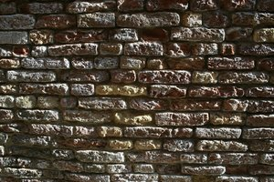 Old bricks in oblique light: An old brick wall in Venice, lit by very oblique light.