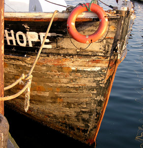 Hope: A weatherbeaten fishing boat in Newport, RI