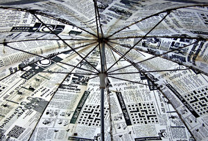 old news umbrella: unusual umbrella covered in newsprint-style material