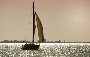 Moonlight sailing: sailboat in twilight