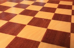 Chess board: An empty, wooden chess board