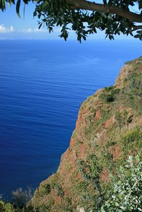 Atlantic blue view: A clifftop view of the Atlantic Ocean from the south coast of Madeira.