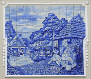 Traditional Madeiran life: Ancient glazed tile picture of women sewing in Madeira.