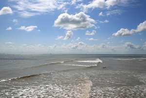 Lone surfboarder: A lone surfboarder in the sea off Kent, England.