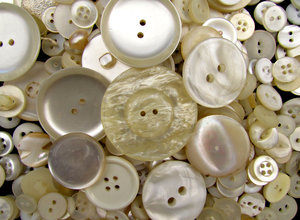 pearly buttons: a variety of different sized, shaped white & pearly buttons