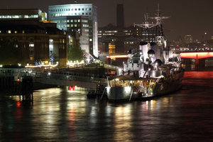 london nights: A night time view of the river thames in london featuring the retired battle ship HMS Belfast and the south bank