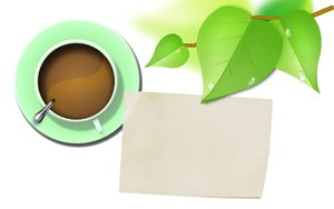 Coffee with leaves and paper