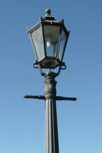 Lamp Post: Ancient lamp post with power saving new light bulb
