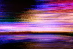 Streaks of Light: Abstract background generated from camera panning on Christmas lights.