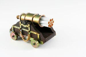 Smoking Kills: Miniature cannon with cigarettes in its barrel. A visual concept to convey that smoking kills.