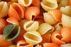 Odd Pasta Out: Conchiglie pasta with a single green shell to contrast against all the yellows and oranges.