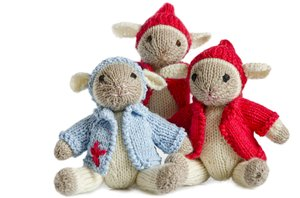Three knitted little lambs