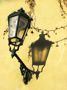 Lantern on yellow wall