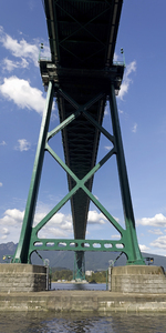 Suspension bridge: View from underneath of Lions Gate suspension bridge across the Burrard Inlet, Vancouver, Canada. Two-shot photomerge.