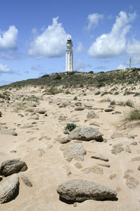 Lighthouse: A lighthouse by a beach in southern Spain.