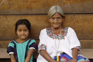 generation gap: A qeqchi indian grandma with her granddaughter in Carcha, Guatemala