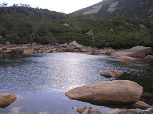 Pond near Szklarska Poreba: A mountain lake with some rocks.
