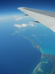 Caribbean Flight: Flying over islands within the caribbean sea somewhere close to Cuba and Jamaica.