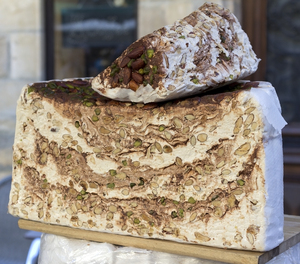 Nougat: A large hunk of nougat on sale in a market in France.