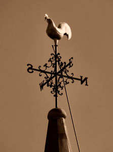 old weather vane1: sepia image of old weather vane