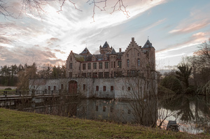 Castle in Tillegembos: A picture of the castle in Tillegembos, Bruges area, Belgium with the sky and clouds in the background near sunset.