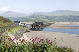 Railway bridge: The railway bridge and causeway across the Mawddach Estuary, Wales.