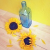 Sunflowers and glassware