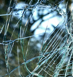 glass spider web: car wreck's cracked glass windscreeen
