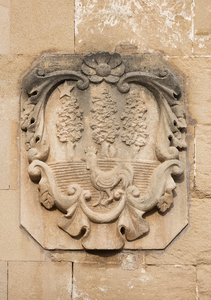 Old stone crest: An old stone crest on a house wall in Majorca, Balearic Islands, Spain.