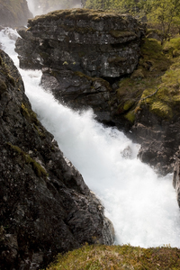 Waterfall: A fierce waterfall fed by snow melt in Norway.